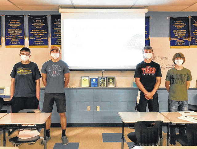 Versailles FFA members Kristopher Marshal, Alex Kaiser, Caleb Kaiser and Jayden Groff are shown finishing up their group presentation in Environmental and Natural Resources in which they placed second in state.