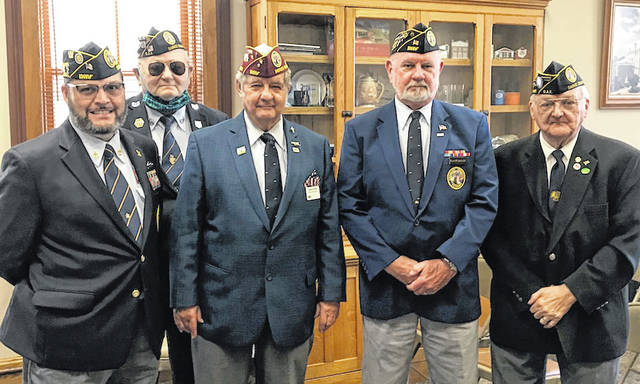 Shown from left to right are Steven Eldred, Lesley Cantrell, Commander Robert A. Foster, Ken Wombold, and Ivan Christian. All of the men pictured are members of the local chapter 57 of the Disabled American Veterans.