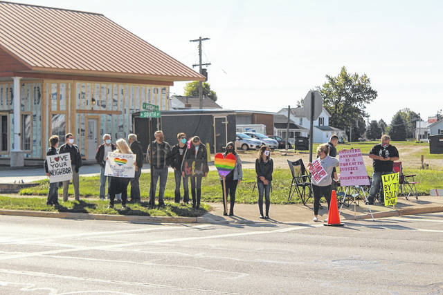 The Rainbow Alliance of Darke County held an LGBTQ protest on Saturday to show their support for Arcanum same-sex couple Bradley O'Dell and Mike Stone.