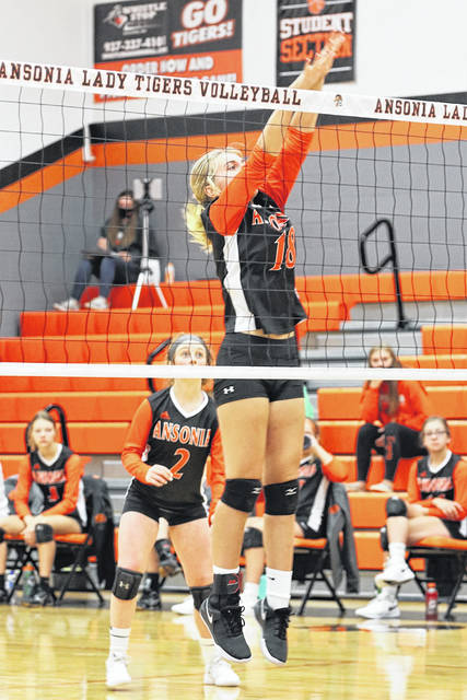 Kylee Winner gets a block for the Ansonia Lady Tigers in Satuday home match.