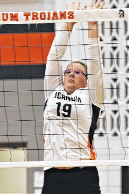 The Lady Trojans' Hannah Smith gets a block in Arcanum's league win over the Twin Valley South Lady Panthers.