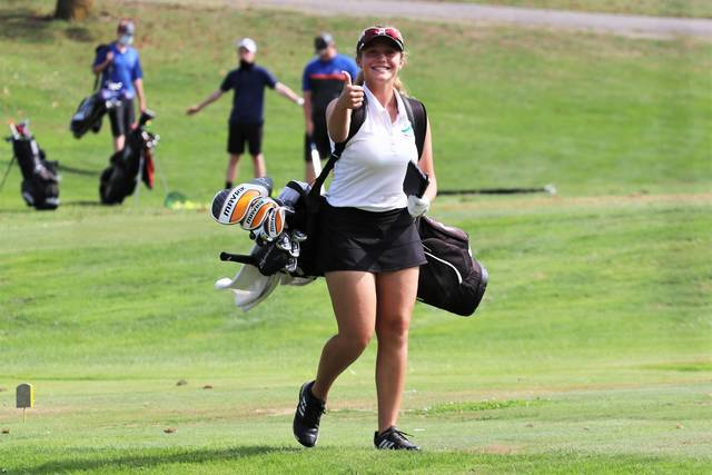 Greenville's Kenna Jenkinson gives a thumbs up on her way to the golf tee.