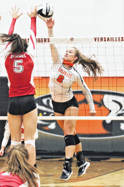 Kirsten Bomholt goes to the net for Versailles in the team's home volleyball match with St. Henry.