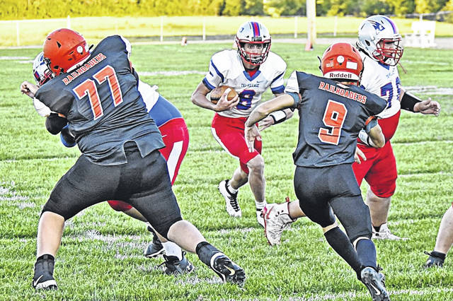 TV quarterback, Layne Sarver carries for the Patriots in win over the Bradford Railroaders.