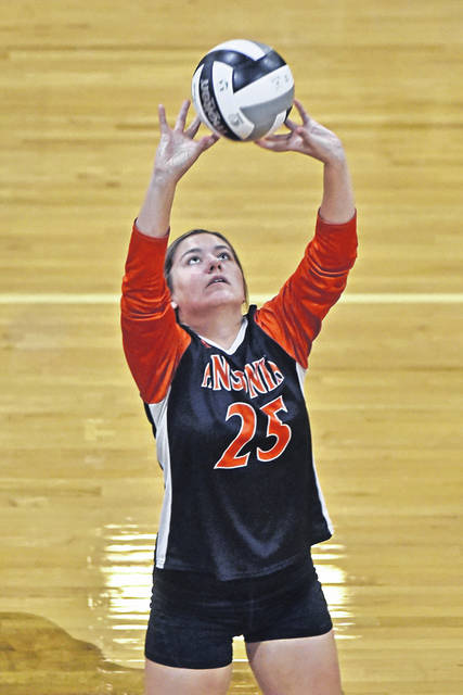 Rylie Marker makes a set for Ansonia in the Lady Tigers road match at Tri-Village.