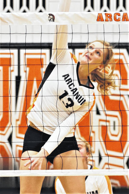 Taylor Gray drills a kill for Arcanum in the Lady Trojans 3-0 Cross County Conference win over the Newton Lady Indians.
