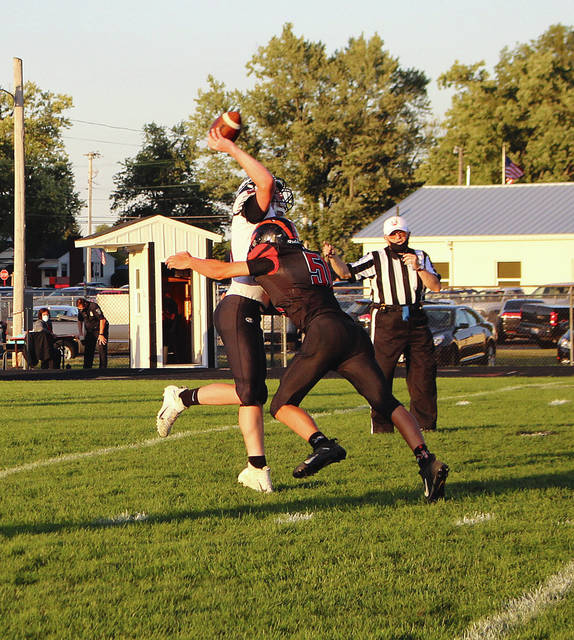 Rob Kiser|Daily Advocate Arcanum's Cael Gostomsky puts a big hit on MV quarterback Zach Connor Friday night.