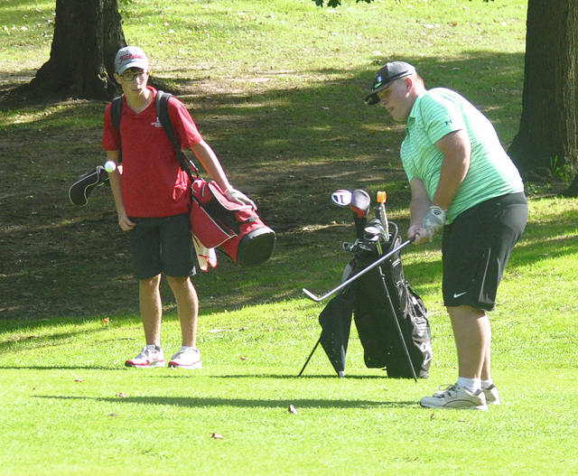 Greenville's Ash Williams chips on to the 18th green Monday.
