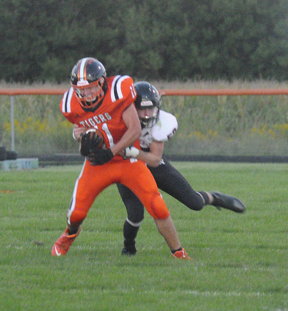 Ansonia's Peyton Beam fights for yardage as Mississinawa Valley's Tanner Perkins makes a tackle.