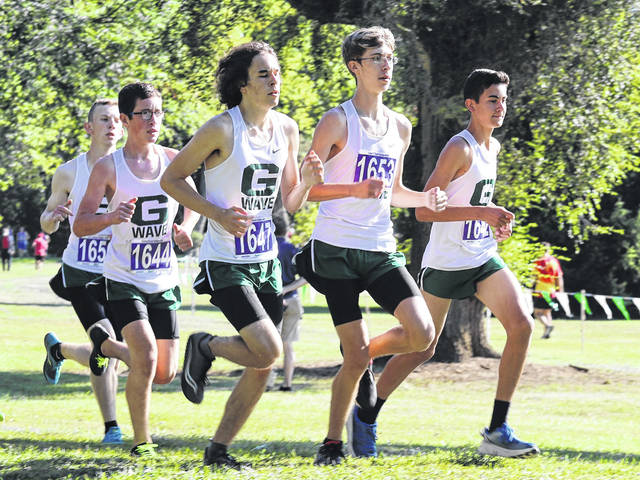 Greenville varsity boys cross country runners wind their way through the Treaty City Invitational cross country meet.