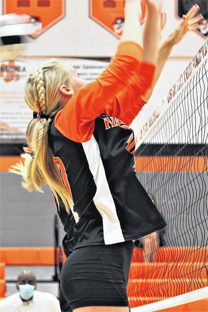 Ansonia's Abby Kramer goes to the net for a block in the Lady Tigers win over the visiting Yellow Springs Lady Bulldogs.
