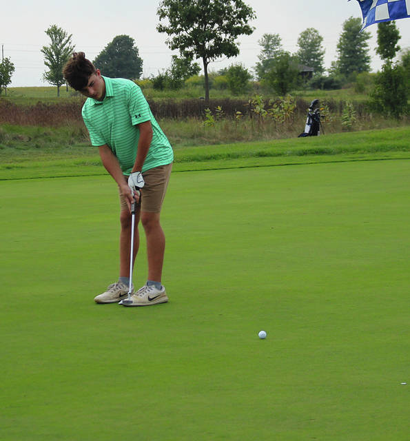 Greenville's Evan Saylor hits a putt on the second green Thursday at Echo Hills.