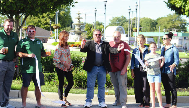 Rob Kiser | Daily Advocate Mayor Steve Willman reacts after cutting the ribbon to celebrate the Grand Re-Opening of Downtown Greenville's Frist Friday at Rotary Park Friday night. From the left are Mike Rieman, Ryan Delk, Susan Fowble, Mayor Willman, Ryan Berry, Hillary Holzapfel, Hallie Riethman and Melissa Reithman