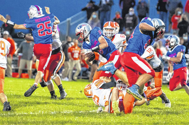 Layne Sarver carries for Tri-Village in the Patriots win over National Trail.