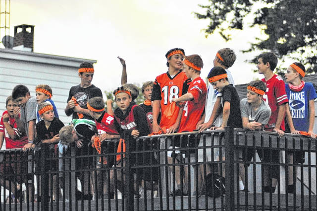 Young Tigers' fans root on the home team in Versailles win over Ft. Recovery.