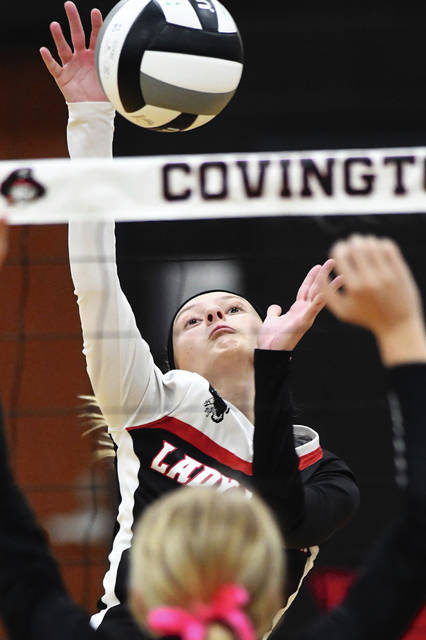 Mississinawa Valley's Riley Price hits the ball against Covington Tuesday night.
