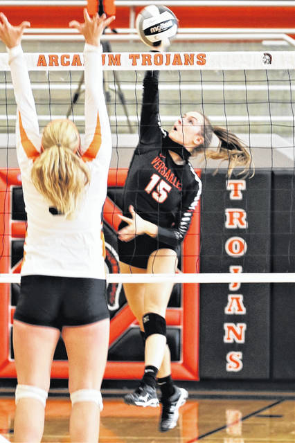 Jenna Marshal drills a kill for Versailles in the Lady Tigers win at Arcanum