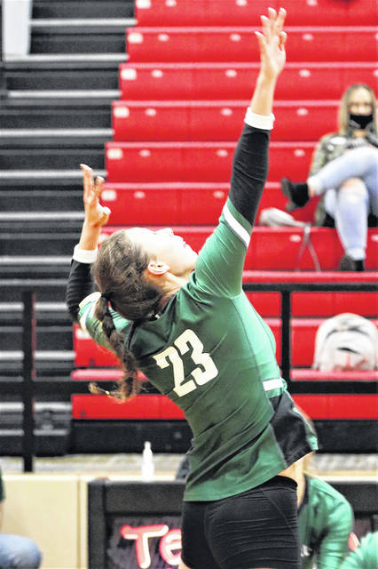 Abbie Yoder goes for a kill in the Lady Wave's tournament match with Benjamin Logan.