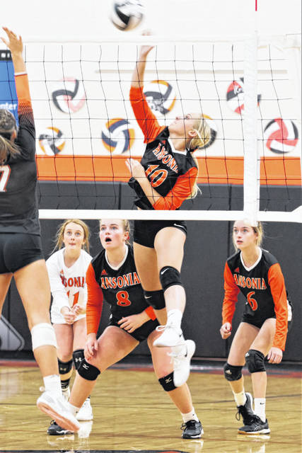 Abby Kramer goes up for an Ansonia kill in volleyball match with the Bradford Lady Railroaders.