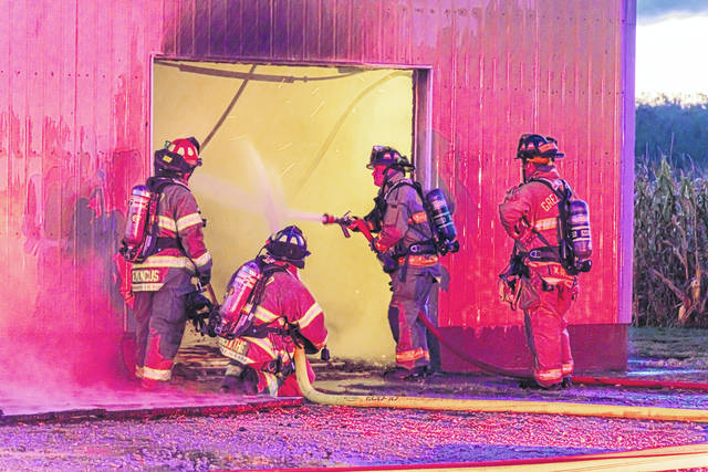 Fire fighters battled a blaze Friday morning at a poultry farm in Liberty Township.