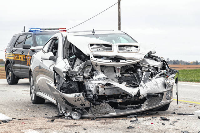 Two people received medical care following a three-vehicle crash Wednesday near Greenville. One driver was cited.