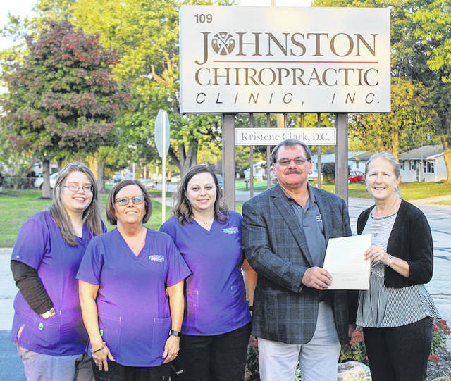 Greenville Mayor, Steve Willman, poses for a photo with Dr. Kristene Clark and some of her associates from Johnston Chiropractic Clinic in Greenville. Shown from left to right are Kylie Shepherd, Kim Archey, Melissa Billig, Mayor Steve Willman, and Dr. Kristene Clark.