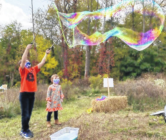 Visitors enjoy the Darke County Parks' first Fall Family Fun Day Saturday, Oct. 10.
