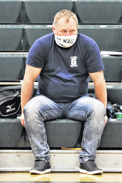 Greenville volleyball coach, Jim Hardesty watches the Lady Wave earn a win over the Lady Patriots on Military Appreciation Night.