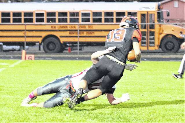 Ian Baker scores for Arcanum in the Trojans Saturday night OHSAA playoff win over Dixie.