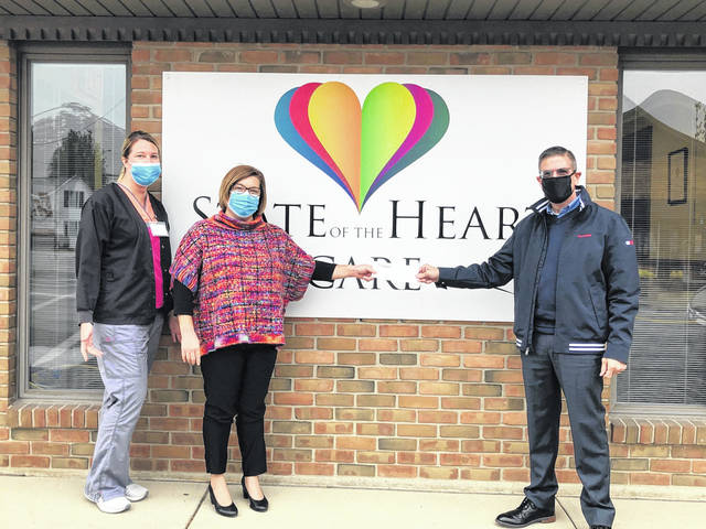 Shown are Tim Bigham, Mercer Savings Bank's Vice President of Operations, presenting a check to State of the Heart's Joyce Steinke, QAPI Coordinator, and Kristi Strawser, Executive Director.