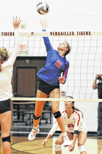 The Lady Patriots' Maria Petry drills a kill for Tri-Village at Versailles.