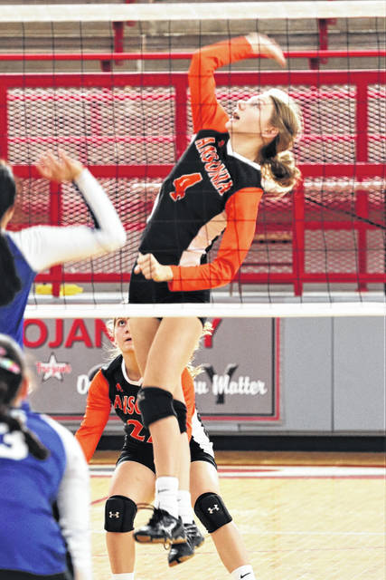 Ansonia's Molly Barga goes strong to the net in OHSAA tournament play.