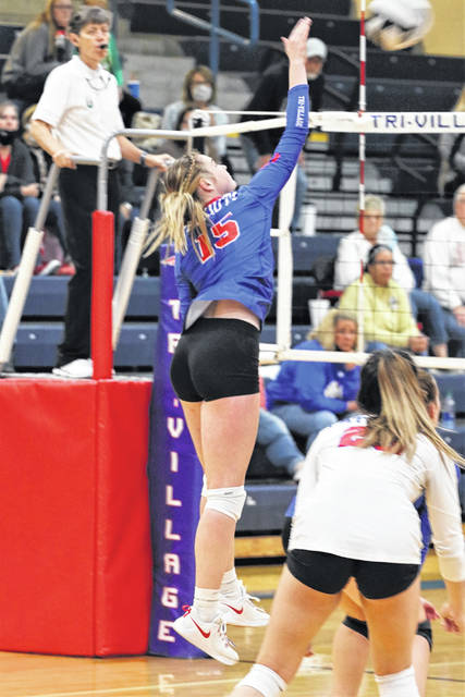 The Lady Patriots Morgan Hunt knocks down a spike in the team's win over the Lady Trojans.