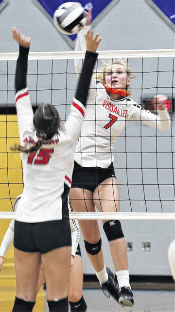 The Lady Tigers Natalie Dirksen slams a spike for a point in Versailles win over the Greenon Lady Knights.