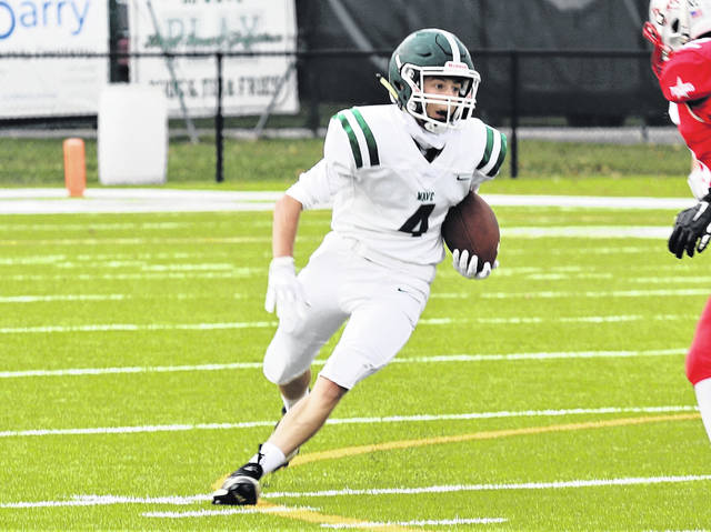 Noah Ellis picks up yards for the Greenville JV squad in MVL game with Troy.