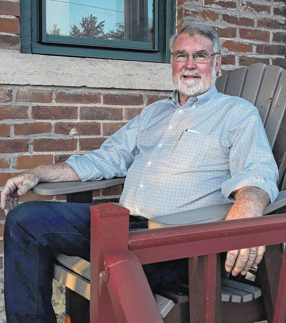 Pastor Steve Short sits on the front porch at Beamsville Christian Church Counseling Center in Greenville.
