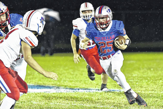 The Patriots Reed Wehr carries for Tri-Village in OHSAA football playoffs.