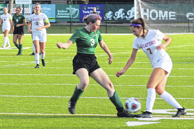 Greenville junior, Sierra Crist battles for control in Miami Valley League soccer play.