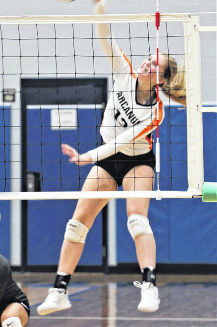 Arcanum Trojans' Taylor Gray drills a spike in OHSAA tournament play at Brookville.