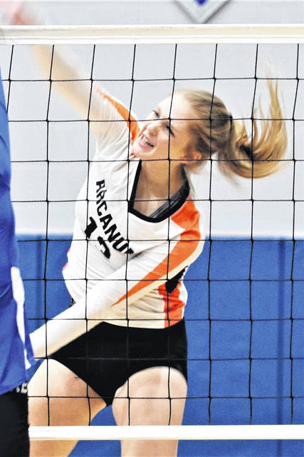 Taylor Gray drills an Arcanum kill in the Lady Trojans tournament win over the Greenview Lady Rams.