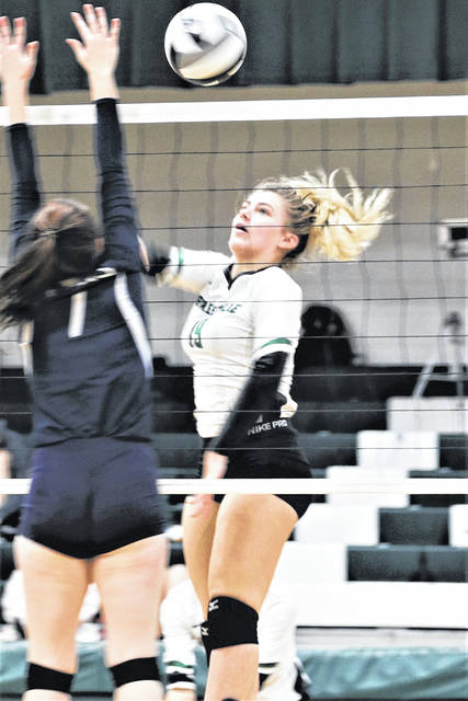 Hunter Class watches her kill sail over the net for a Lady Wave score.