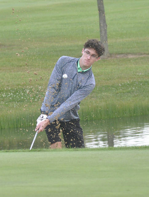 Greenville's Alex Kolb hits a bunker shot on the first hole at Turtle Creek Thursday.