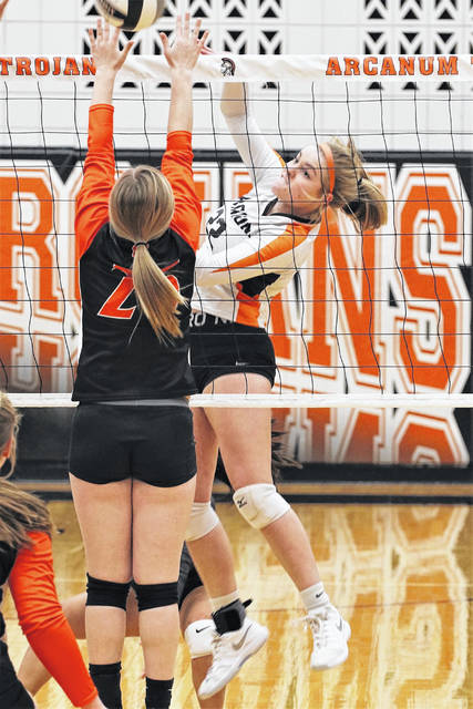 Arcanum's Maddy Byrne slams a spike in the Lady Trojans Tuesday night win over Ansonia.