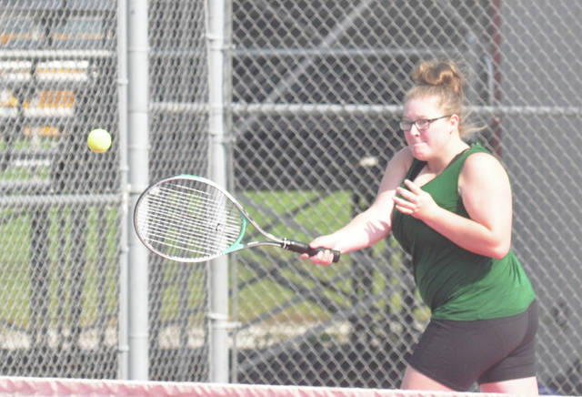 Greenville's Chyanne Hartsock chases down a forehand in a doubles match Tuesday at Troy High School.