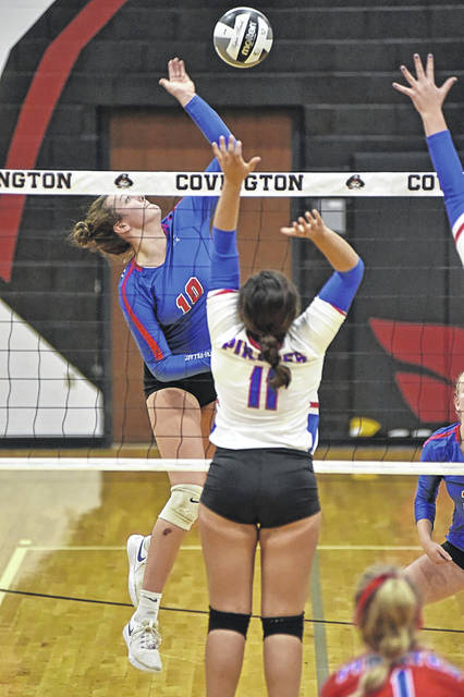 Meghan Downing slams a kill for the Lady Patriots in the team's tournament win over Riverside.