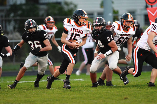 Ansonia's Jackson Shellhaas returns an interception against Covington Friday night.