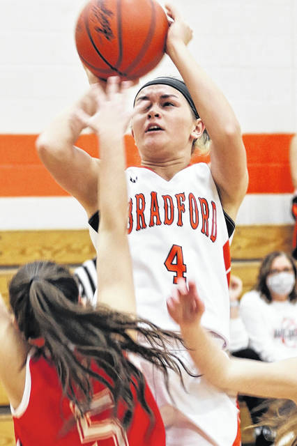 Austy Miller scores two of her game high 19 points in the Bradford Lady Railroaders win over Houston.