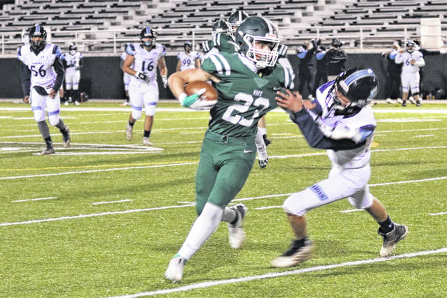 Connor Mills picks up yards for the Green Wave in final game of the season.