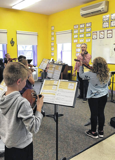 Dr. Robert Gillespie, Chair of Music Education at Ohio State University, conducts a workshop with students from Decolores Montessori School in Greenville. Gillespie is the co-author of the Hal Leonard string method book series, <em>Essential Elements for Strings</em>.