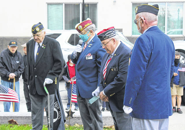 Members of the DAV lay the wreath at the Darke County veterans memorial stone on Veterans Day, Nov. 11, 2020. Shown from left to right: Ivan Christian, Robert A. Foster, Don Dietrich, and Ken Wombold.